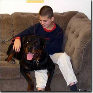 Rottie-Gabriel and KC smiling on couch